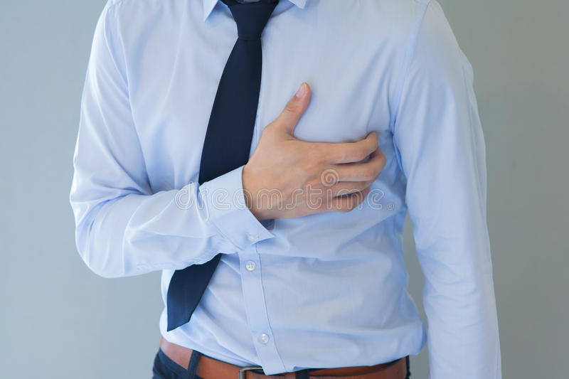 Man having heart-attack / chest pain in isolated background royalty free stock photography