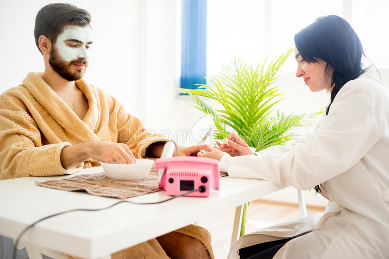 Man Is Having His Nails Done Stock Photo - Image of face, beauty ...