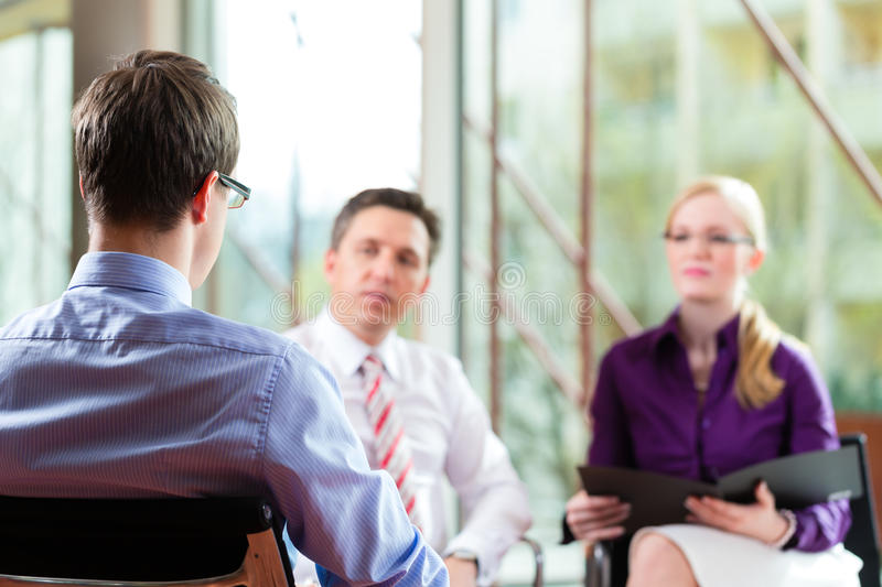 Man having an interview with manager stock photo