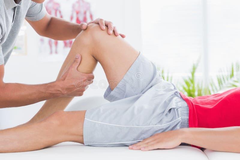 Man having leg massage. In medical office stock photography