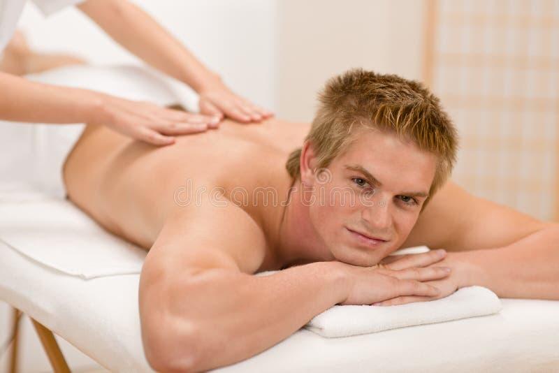 Man having luxury back massage. In spa center royalty free stock photo