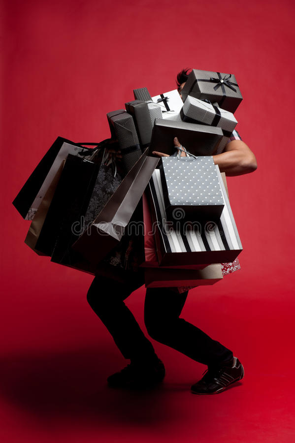 Man having mountain of presents royalty free stock photography