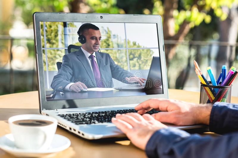 Man Having Online Meeting With His Business Partner. Outdoors stock photo