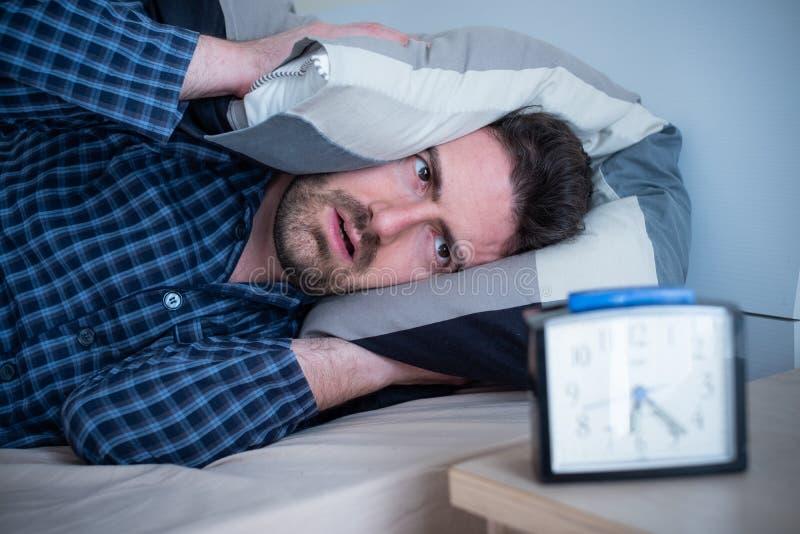 Man having problem sleeping in his bed stock photos