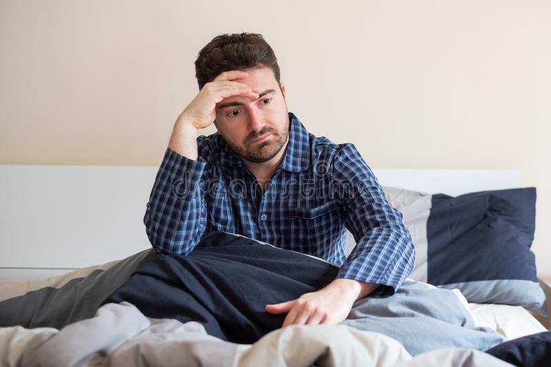 Man having problem sleeping in his bed royalty free stock image