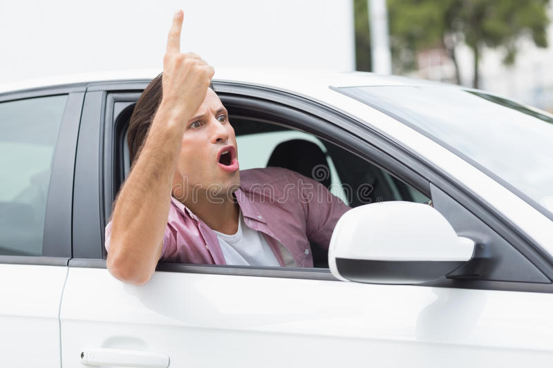 Man having road rage. In his car royalty free stock image