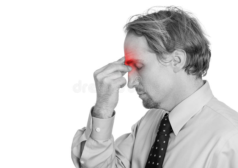 Man having suffering from headache hand on head sinus pressure, red area royalty free stock photo