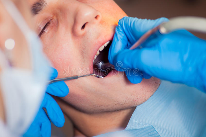 Man having teeth examined at dentists dental royalty free stock photos