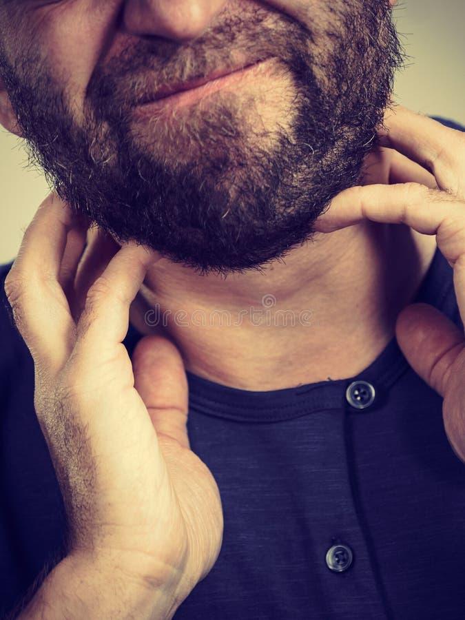 Man having throat, neck pain royalty free stock images