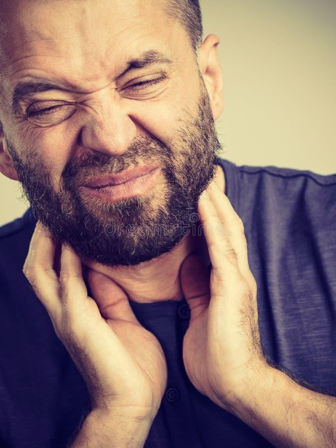 Man having throat, neck pain stock images