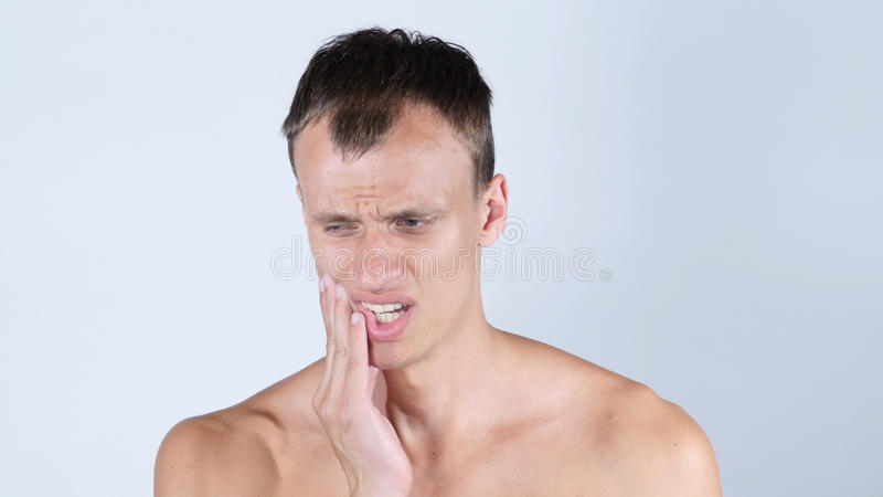 Man having toothache. High quality royalty free stock photography