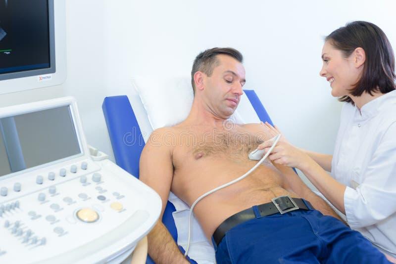 Man having ultrasound around heart stock image