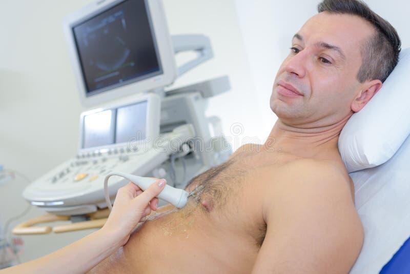 Man having ultrasound heart royalty free stock photos