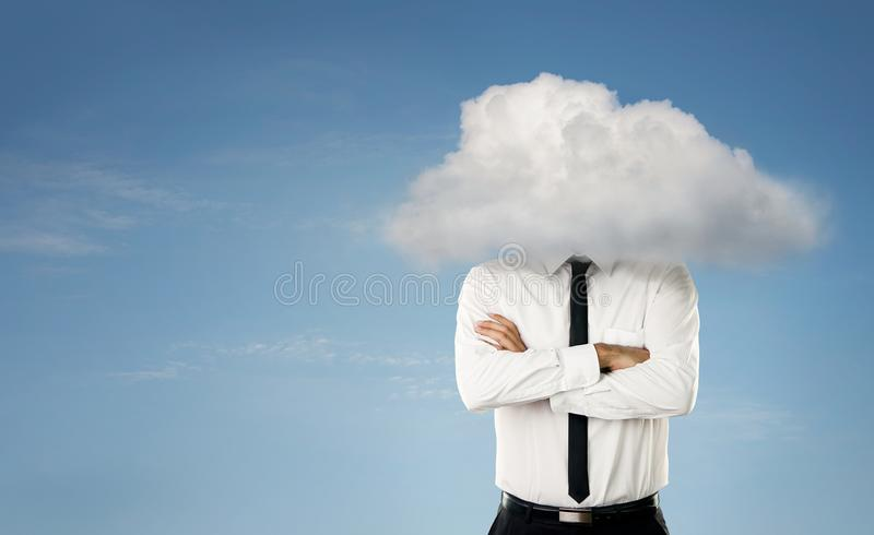Man with head in the clouds stock photo