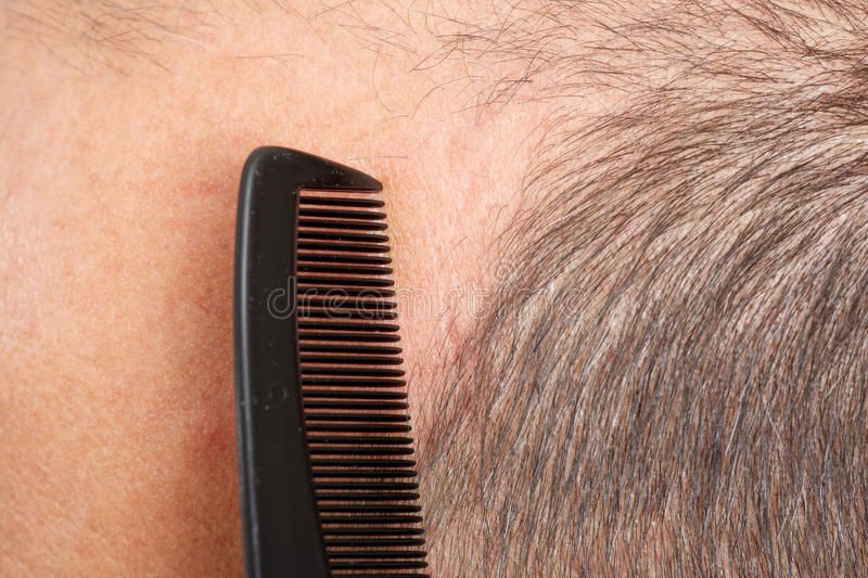 Man head with a comb. stock photo