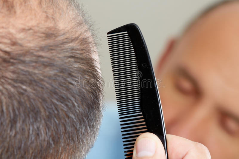 Man head with a comb. royalty free stock photography