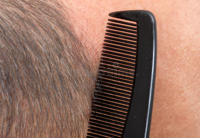 Man head with a comb. stock images