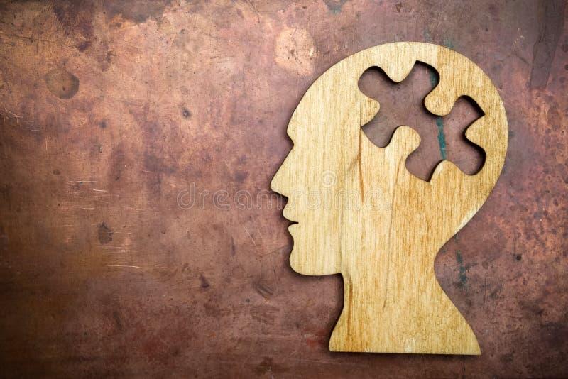 Man head silhouette with jigsaw stock photos