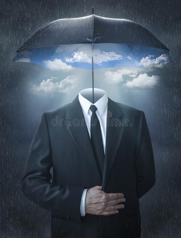 Man without a head under a magic umbrella. stock photo