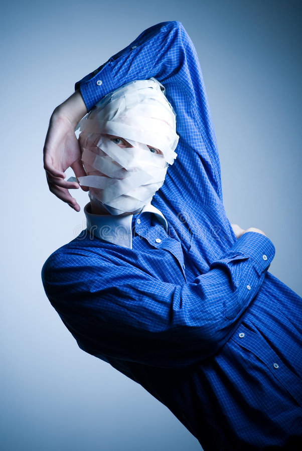 Man with head wrapped in tape royalty free stock photo