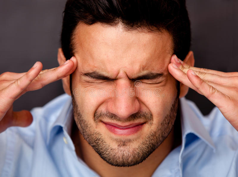 Download Man with a headache stock image. Image of annoyed, executive - 26094157