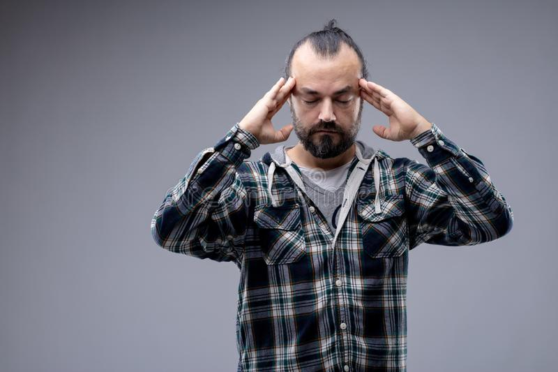 Man with a headache or concentrating stock image
