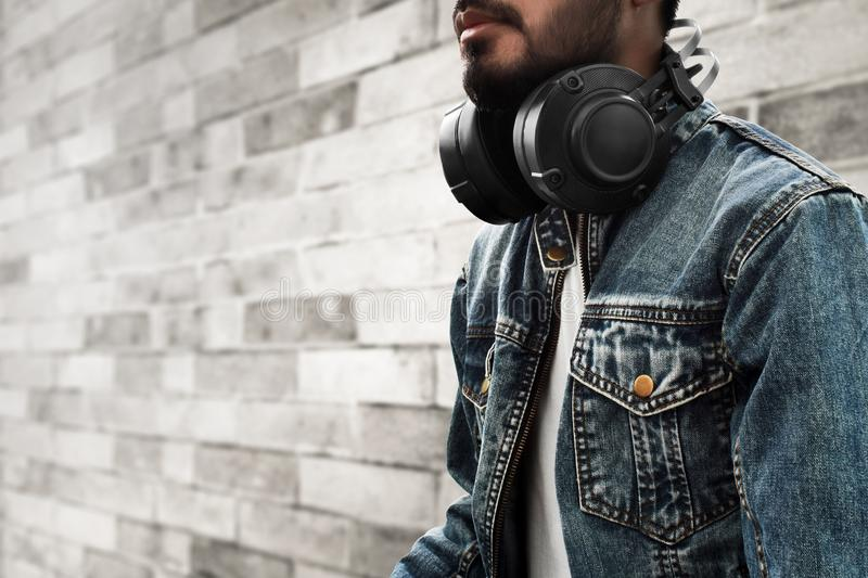 Man with headphone on outside. Man with headphone on outdoor royalty free stock photo