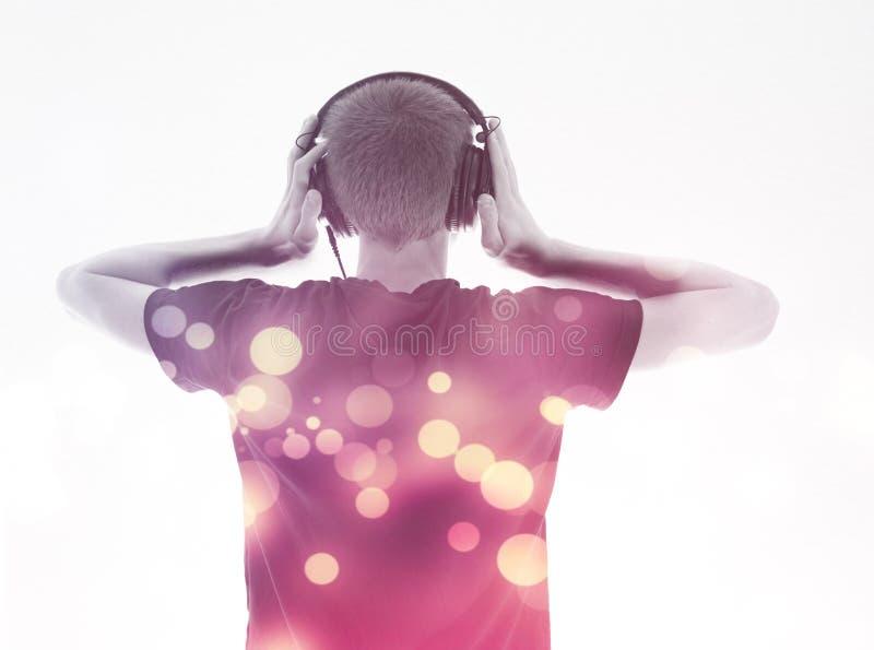 Man with headphones back toward camera royalty free stock photos