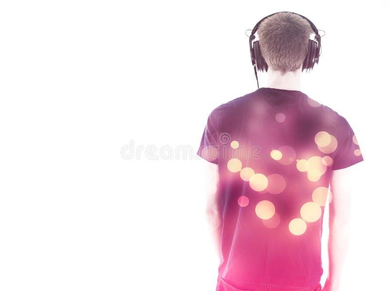 Man with headphones back toward camera royalty free stock photo