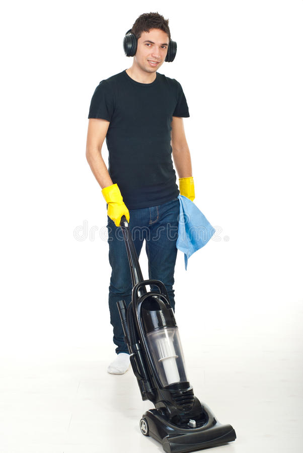 Man with headphones cleaning house royalty free stock photography
