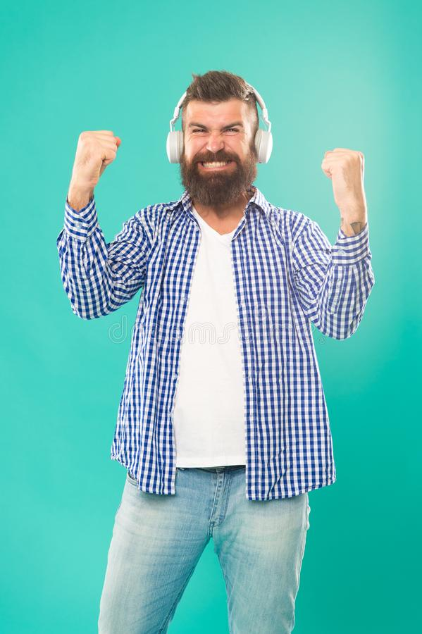Man in headphones. Streaming music sites hippest and hottest around. Wireless technology. User friendly interface and. Large library of tunes. Hipster with royalty free stock photos