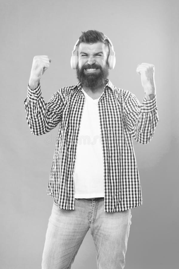 Man in headphones. Streaming music sites hippest and hottest around. Wireless technology. User friendly interface and. Large library of tunes. Hipster with stock photos