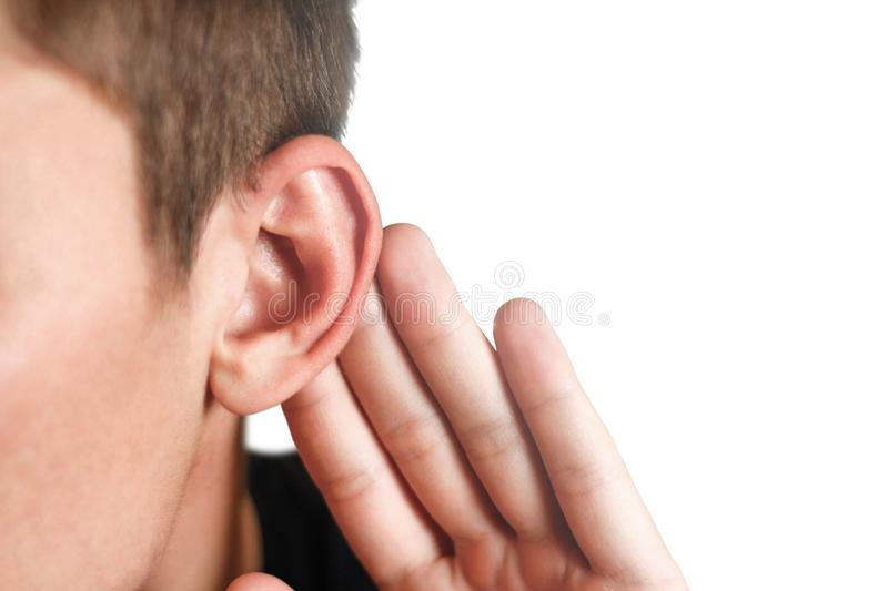 Man with hearing problem on white background. Close up.  stock images