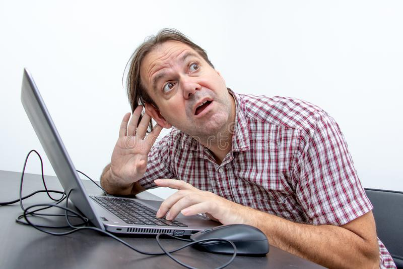 A man hearing the sound in a computer stock image