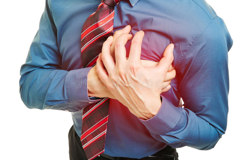 Man with heart attack pressing hands to chest royalty free stock photography