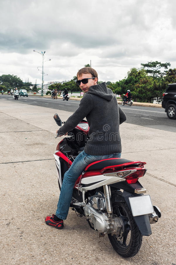 Man without a helmet on motorcycle royalty free stock image
