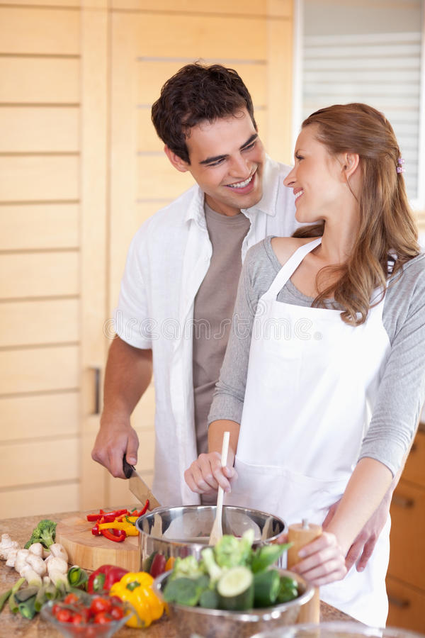 Download Man Helping His Girlfriend Cooking Stock Photo - Image: 22221402