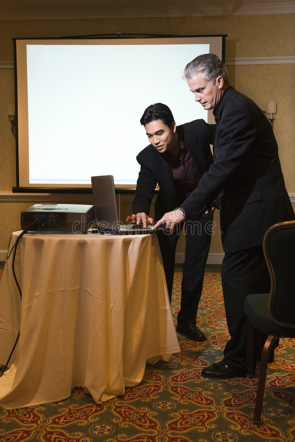 Man helping with presentation. royalty free stock image