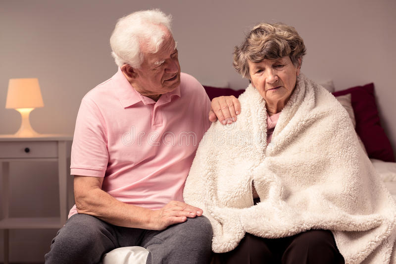 Man helping sad wife. Image of men helping sad wife with health afflictions stock photography