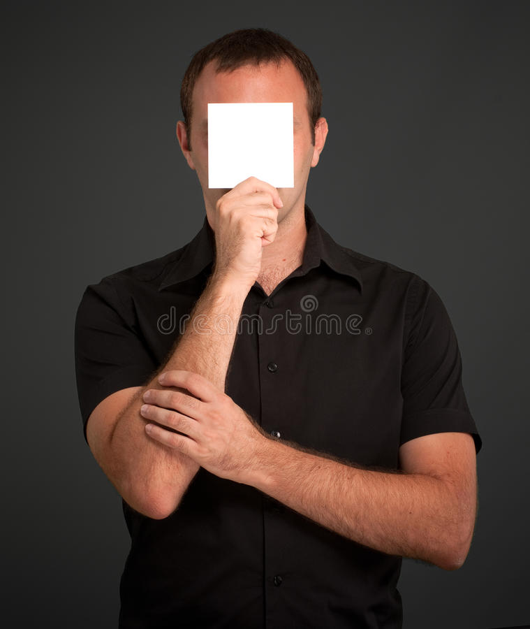 Download Man Hiding Behind A Blank Note Stock Photo - Image: 24728302