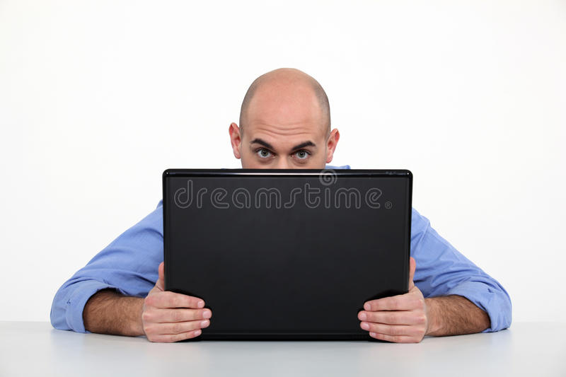 Download Man hiding behind laptop stock photo. Image of ears, peer - 28296856