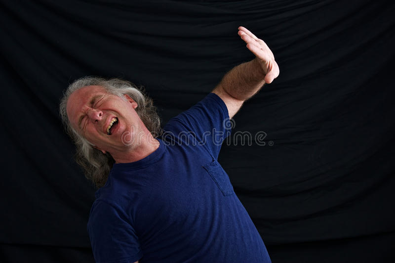 Man Hiding From Explosion Royalty Free Stock Image