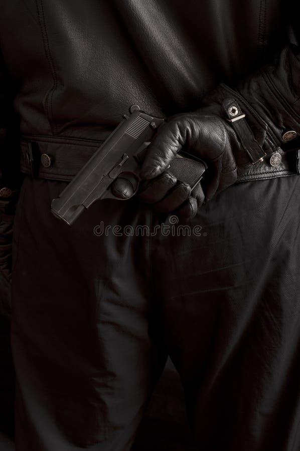 Man Hiding A Gun Stock Image