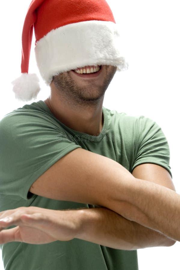 Download Man Hiding His Face With Santa Cap Stock Photo - Image: 6592702