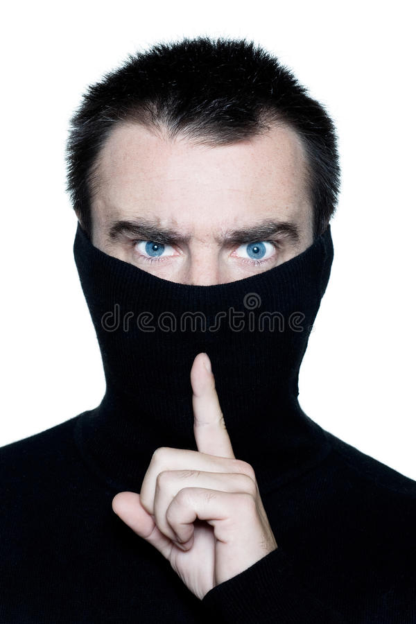 Man Hiding His Turtle Polo Neck Gesturing Silence Stock Image