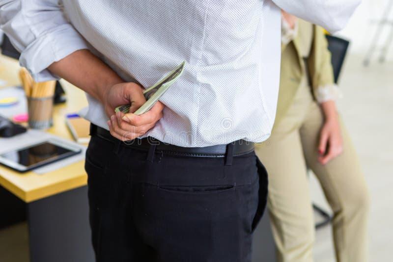 Man hiding money from wife stock photos
