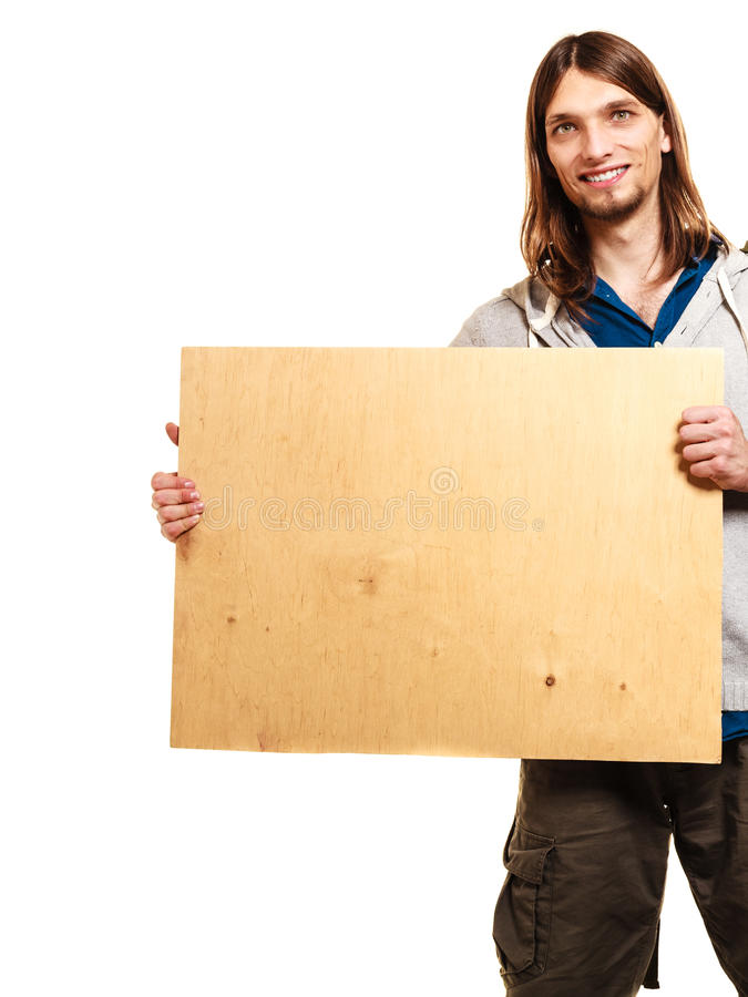 Man hiker backpacker with blank wood copy space ad. Man tourist backpacker holding blank wood banner copy space. Young guy hiker backpacking. Summer vacation stock photo
