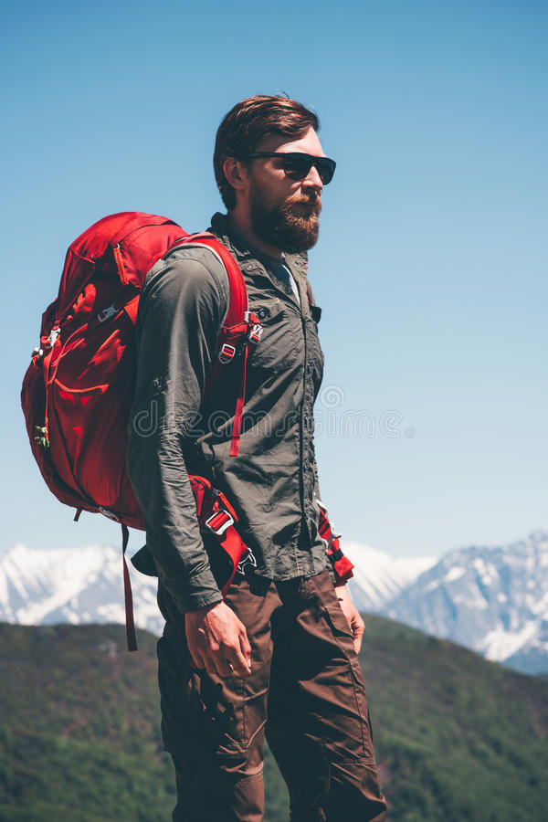 Man hiker climbing in mountains with backpack stock image