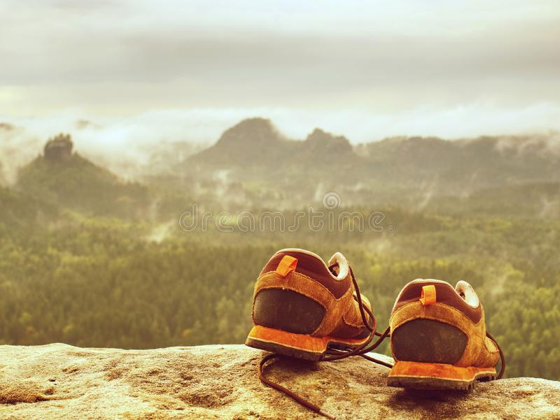 Man hiker legs without trousers and hiking boots on peak. Man hiker legs without trousers and hiking boots on mountain peak stock images