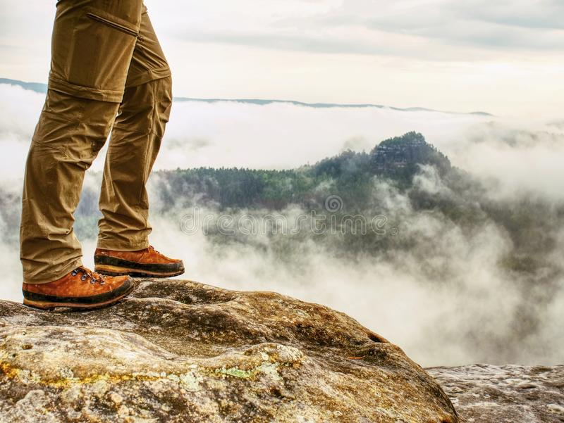 Man hiker legs with windproof trousers and hiking boots royalty free stock image